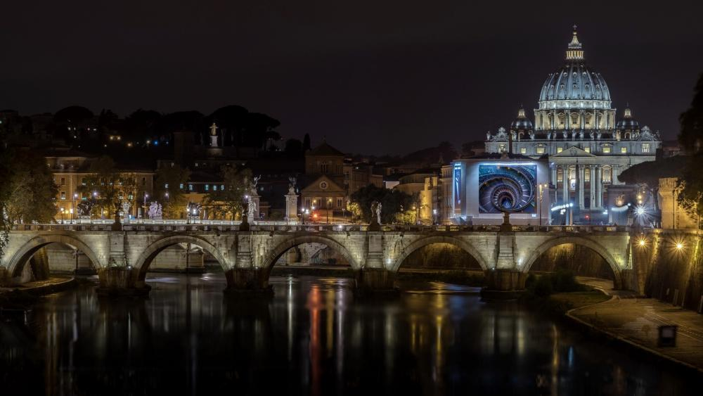 The St. Peter's Basilica and the Bridge Of Angels at night wallpaper