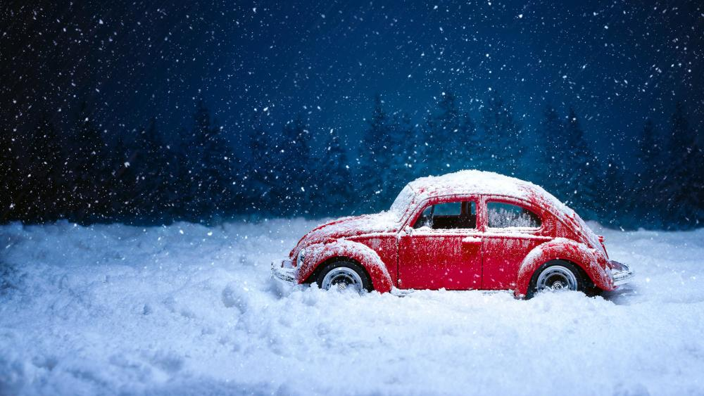Red Volkswagen Beetle in snow wallpaper