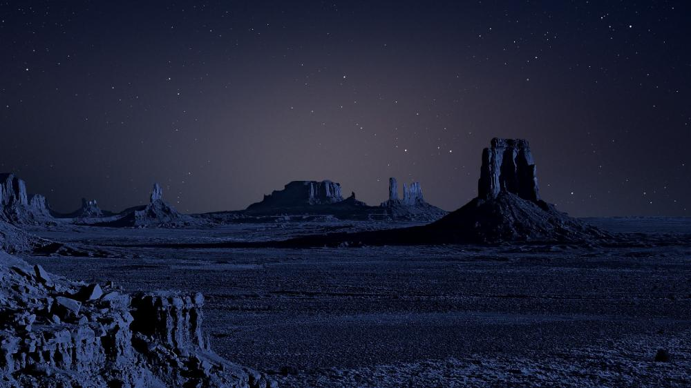Buttes under the starry night sky wallpaper