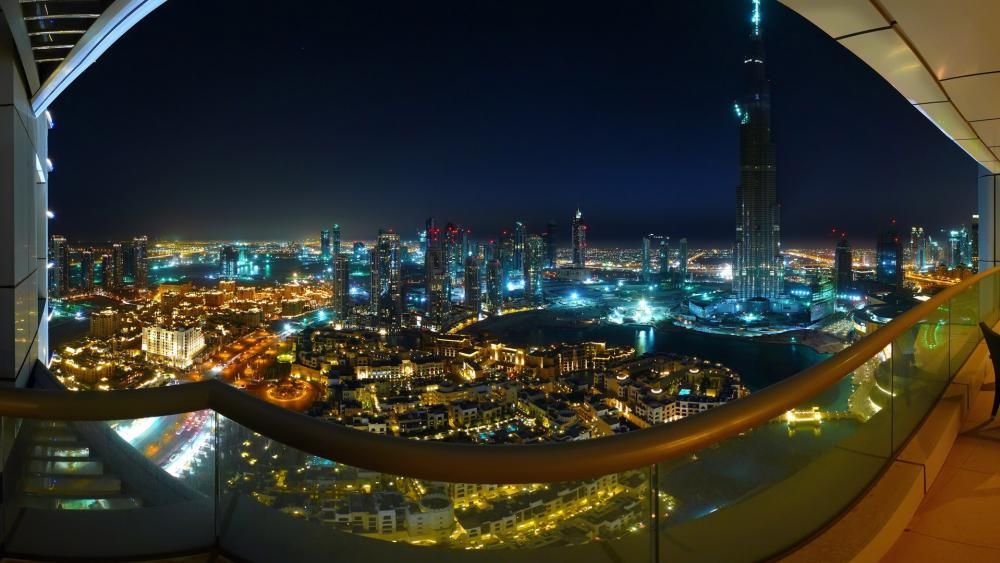 Balcony view of Dubai at night wallpaper
