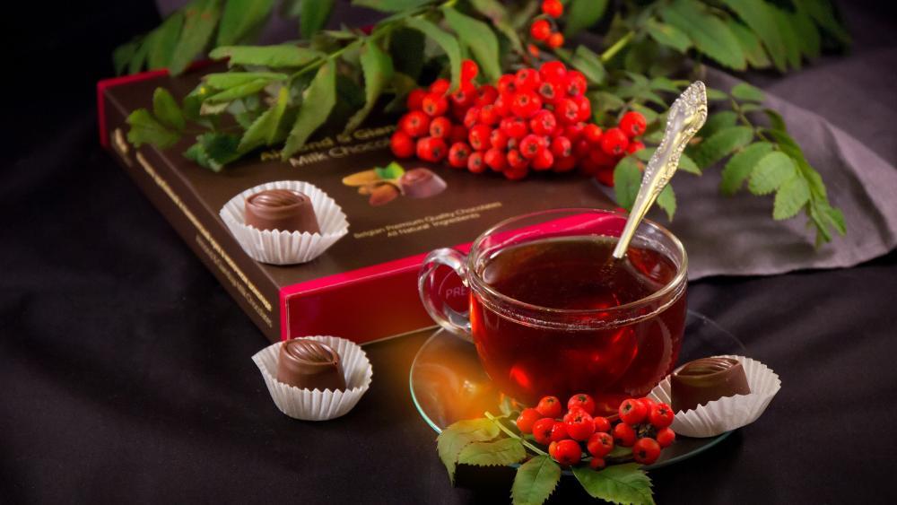 Tea with chocolate bonbon wallpaper