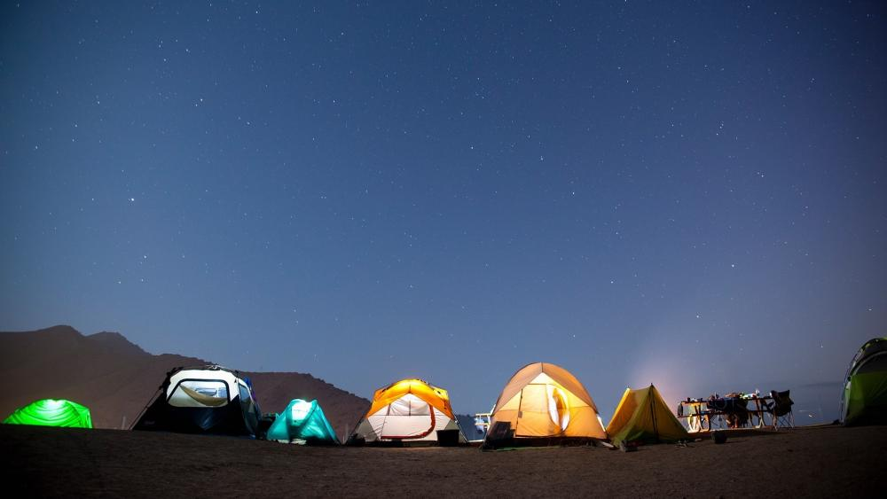 Tents under the starry sky wallpaper