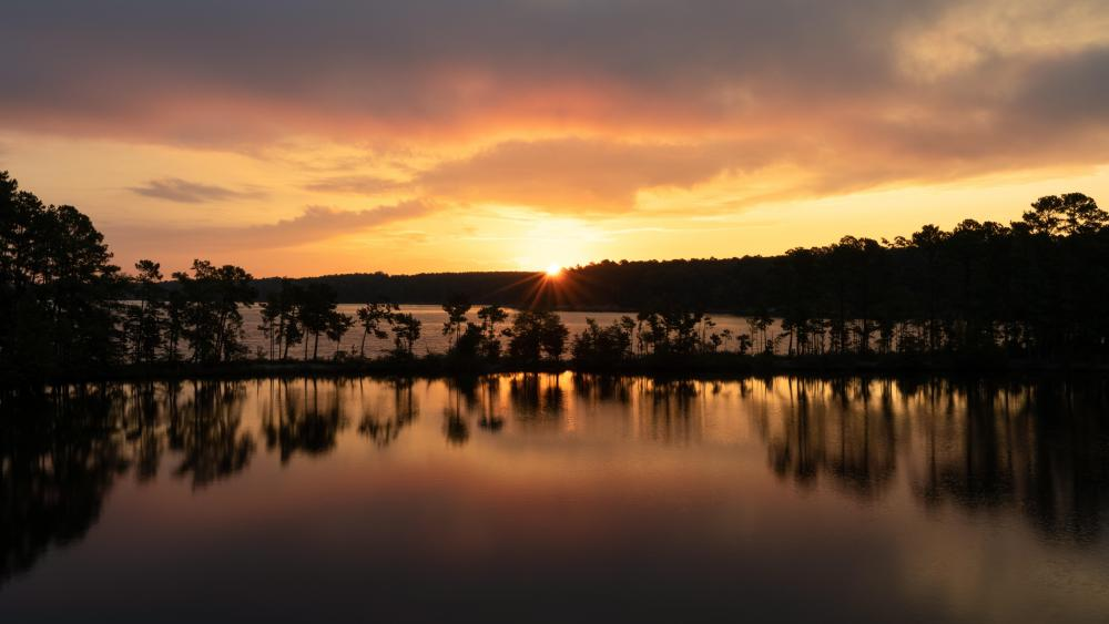 The sun rising over Jordan Lake wallpaper