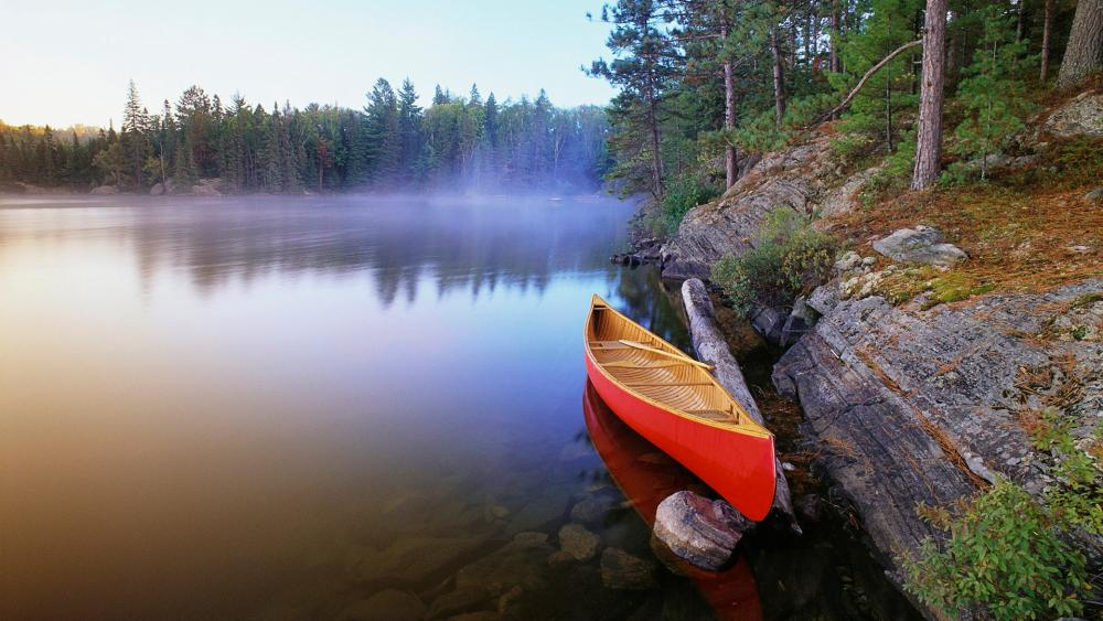 Red canoe on the misty  Pinetree Lake, Algonquin Provincial Park wallpaper