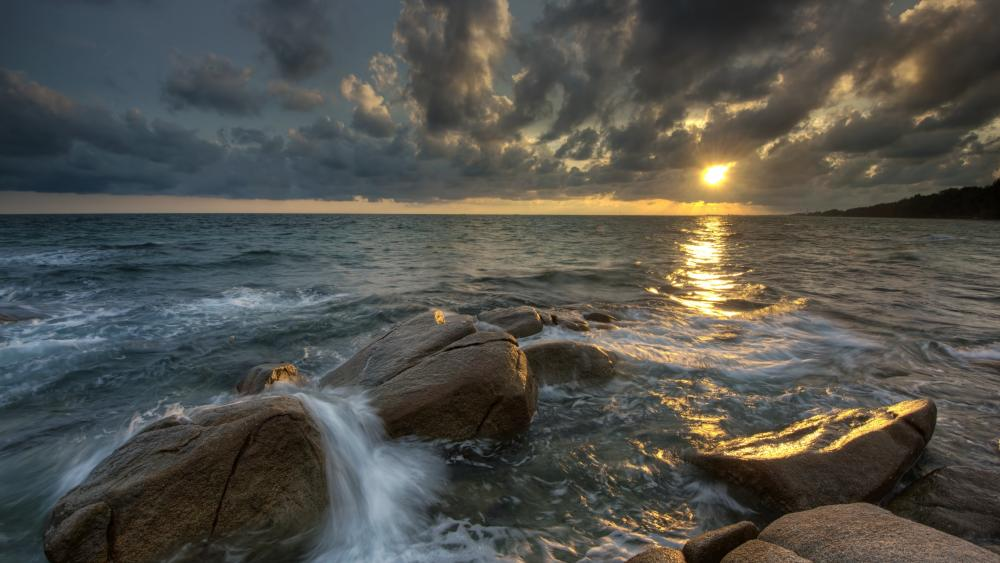 Boulders on the shore wallpaper