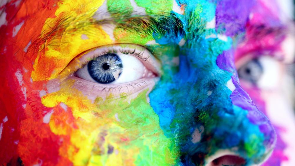 Colorful face with blue eye wallpaper