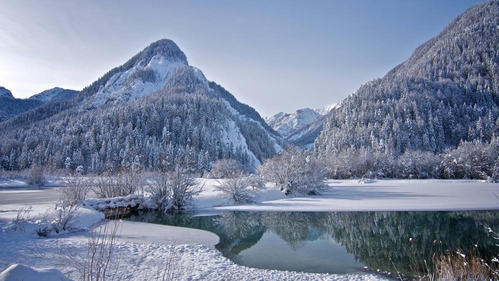 Half-frozen mountain lake wallpaper