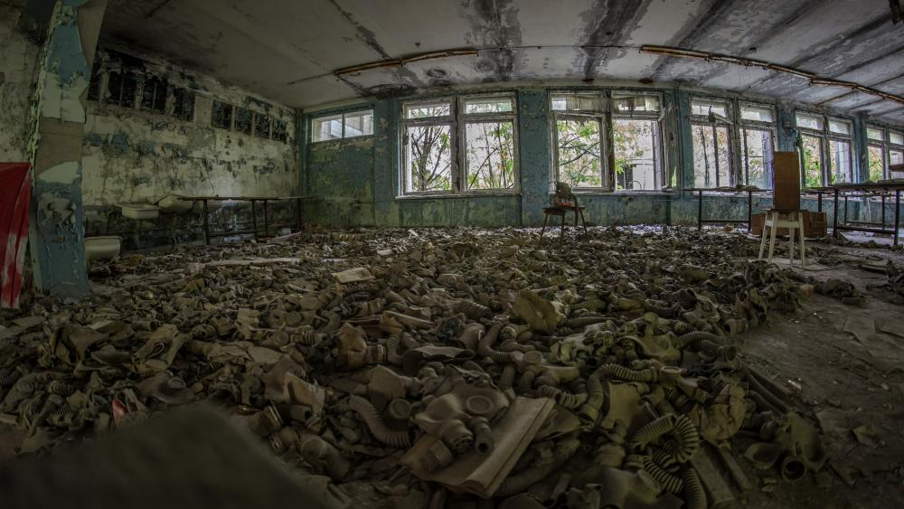 Gas masks on the floor in an abandoned building in Chernobyl wallpaper