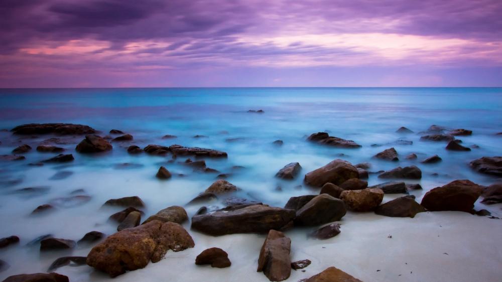 Blue sea and purple sky wallpaper