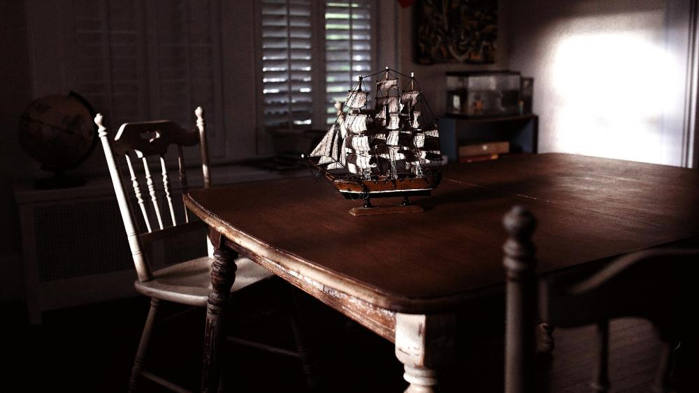 Model ship on the table wallpaper