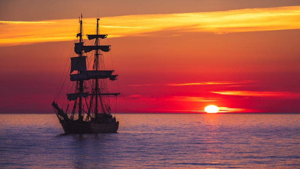 Masted ship in the sunset wallpaper