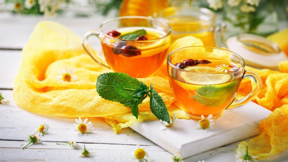 Chamomile tea in glass cuples wallpaper