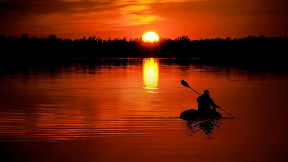 Canoeing at sunset wallpaper