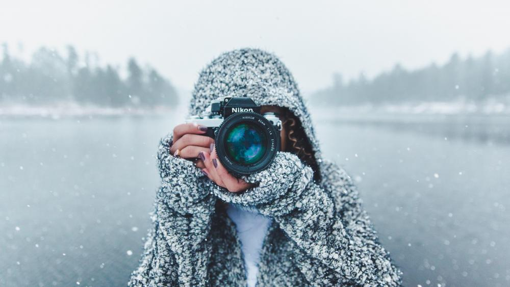Photographer woman in the snowfall wallpaper