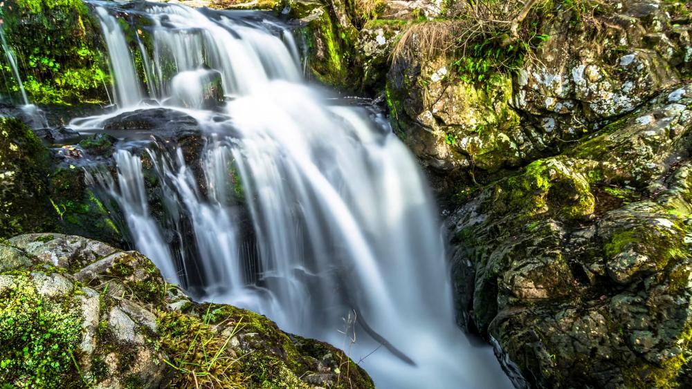 Waterfall in boulders wallpaper