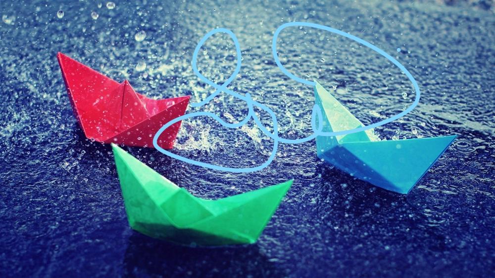 Colored paper boats in the rain wallpaper