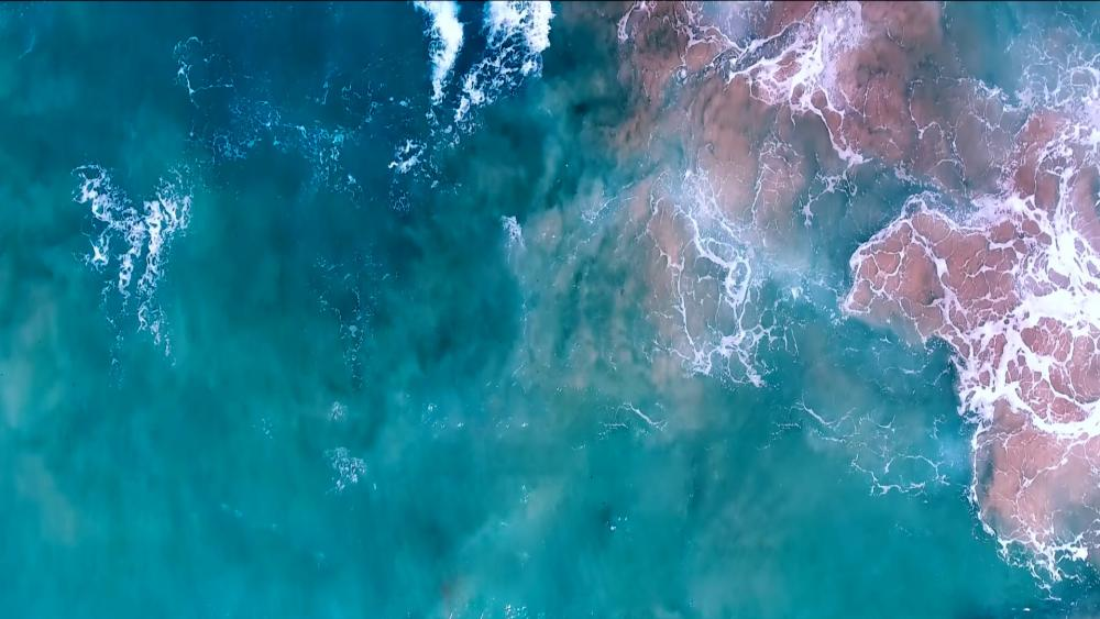 Turquoise sea from above wallpaper