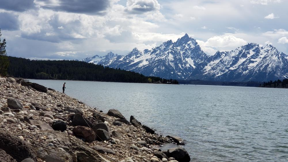 Fisherman by the mountains wallpaper