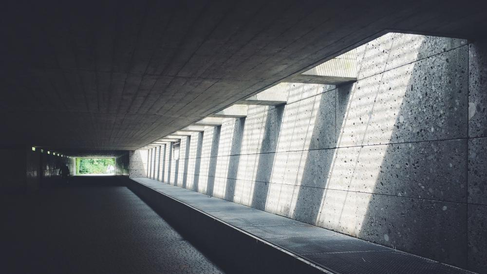 Concrete tunnel with sunrays wallpaper
