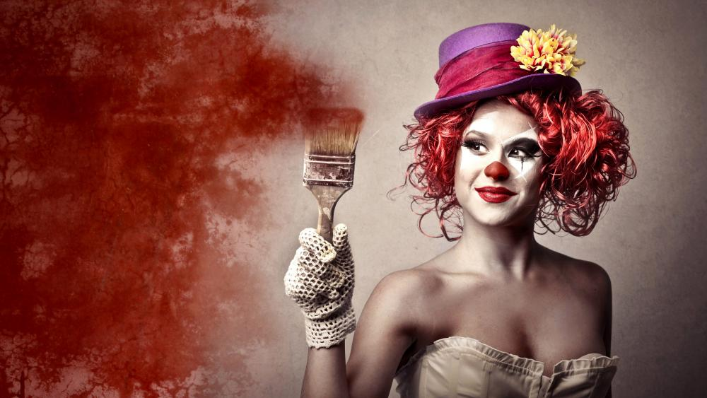 Female clown with paintbrush wallpaper