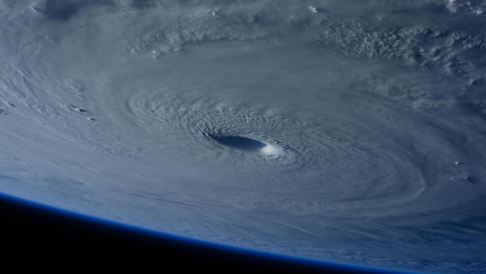 Space Station Flies Over Super Typhoon Maysak wallpaper
