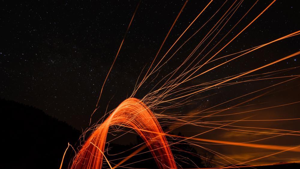 Flying sparks wallpaper
