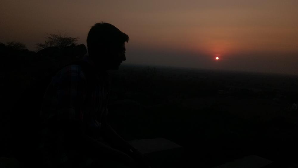boy enjoying sunset wallpaper