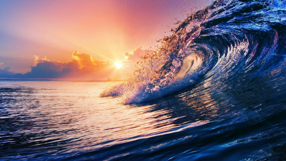 Ocean wave on sunset wallpaper