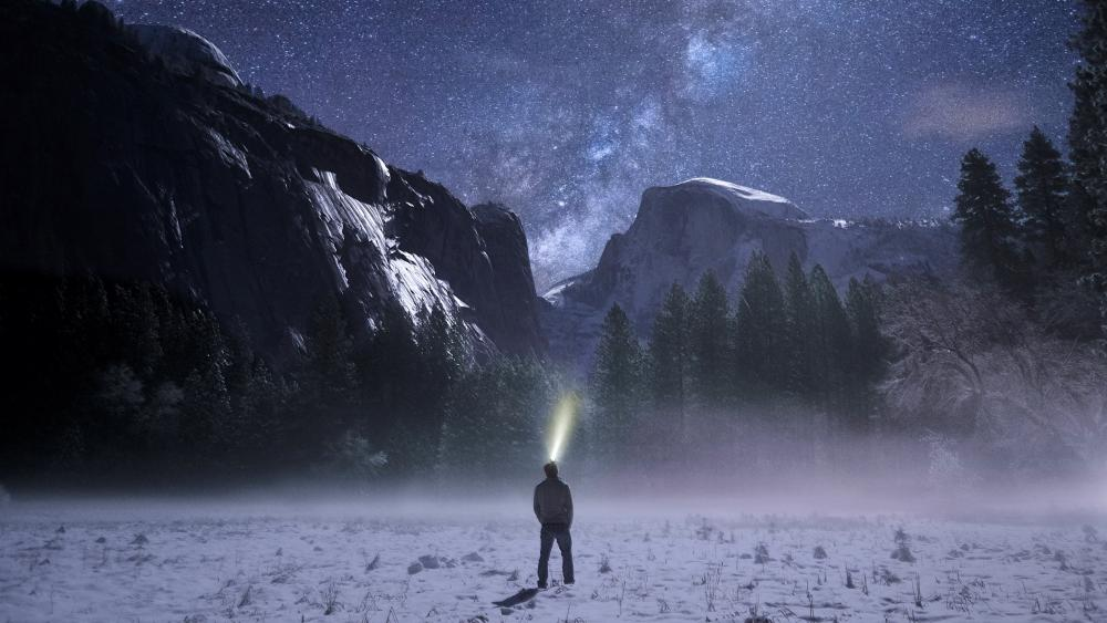 Man with headlight at Yosemite Valley wallpaper