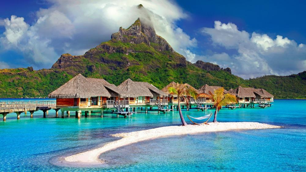 Bungalows in the middle of the beach in Bora Bora wallpaper