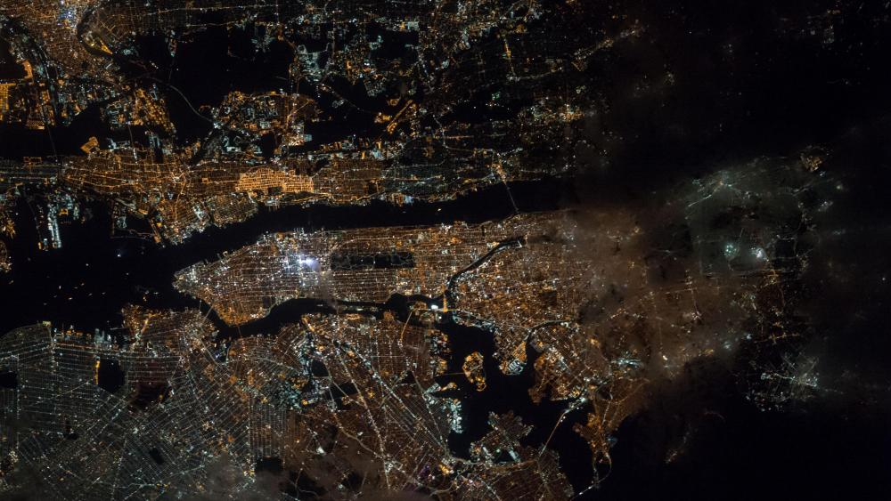 Astronaut's View of New York City at Night wallpaper