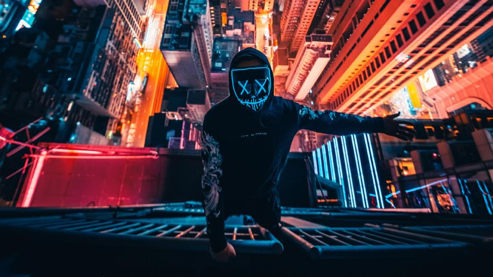 Neon masked guy climbing building wallpaper