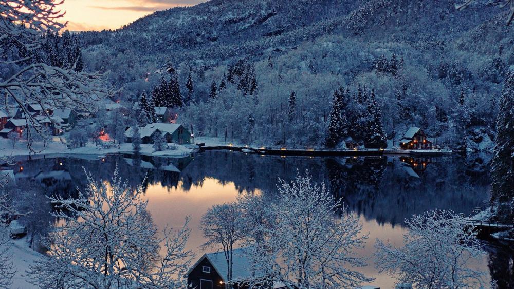 Snowy lakeside houses wallpaper