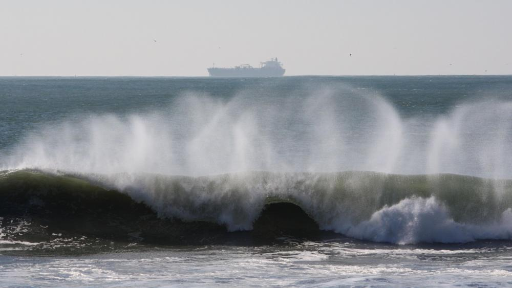 Breaking Wave with a Ship in the Distance wallpaper