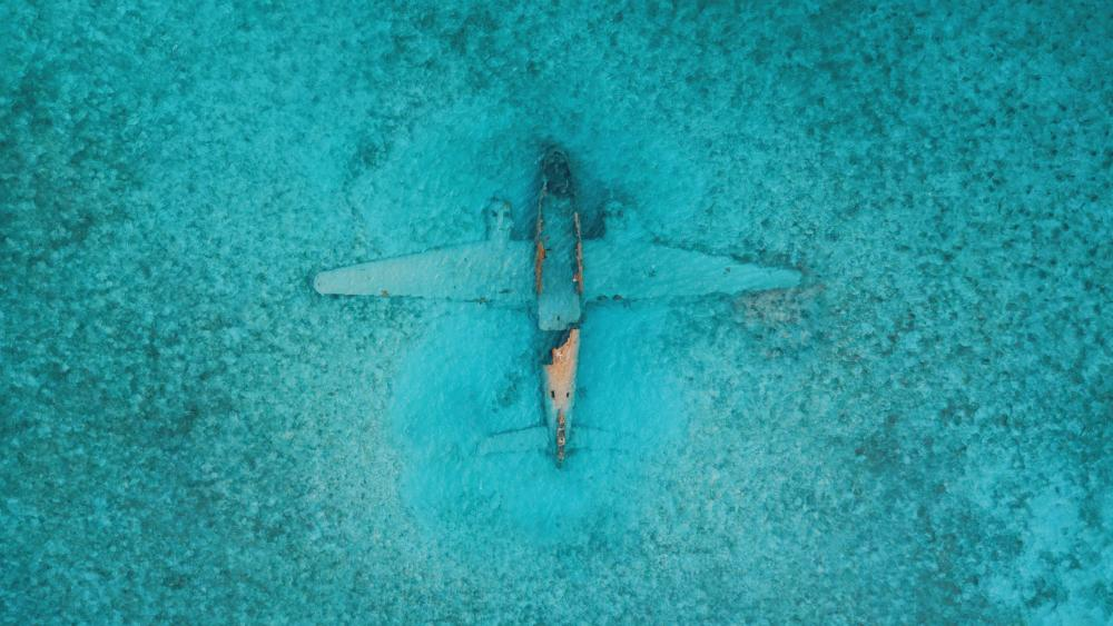 Airplane under the sea from above wallpaper