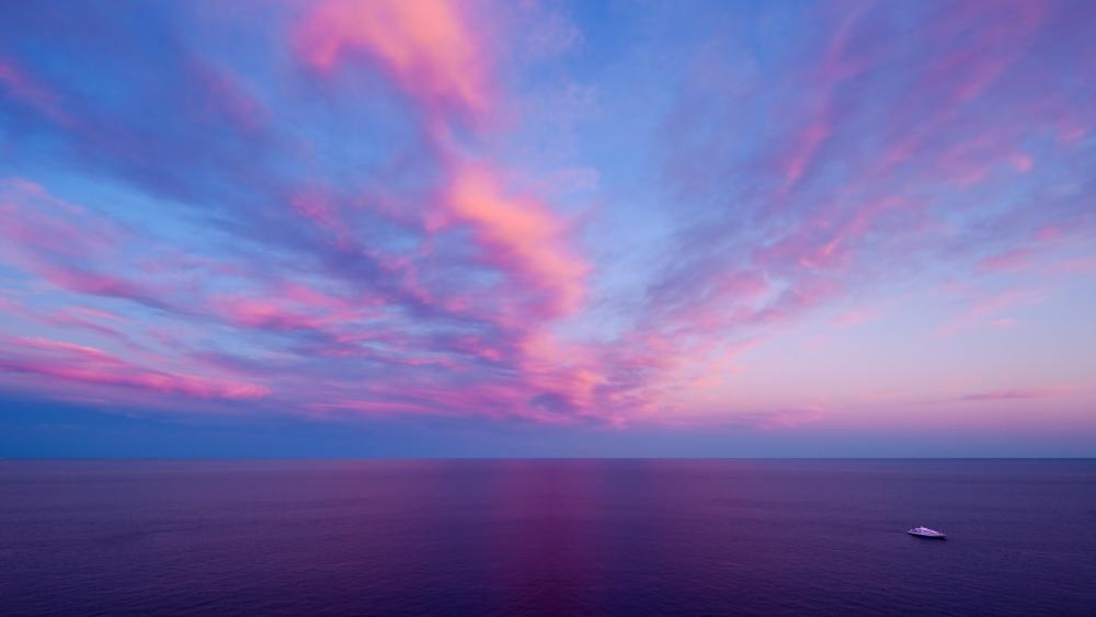 Pink sky and purple sea wallpaper