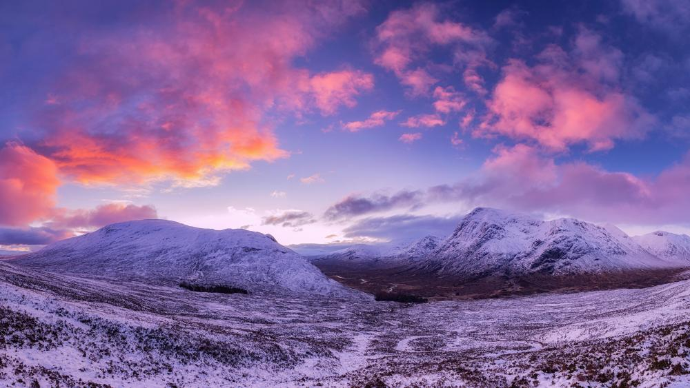 Pink clouds over the snowy mountains wallpaper