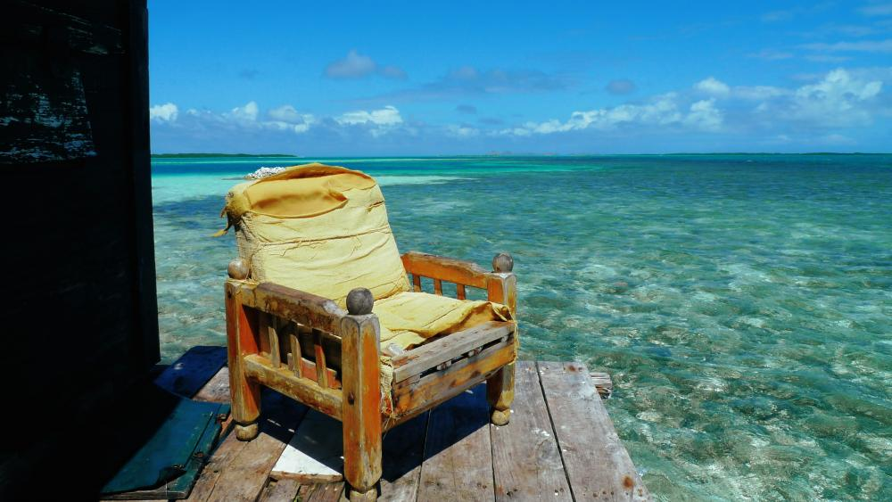 Old chair over the ocean wallpaper
