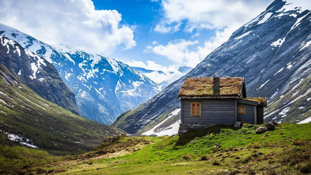 Tiny turf house in Geirangerfjord wallpaper