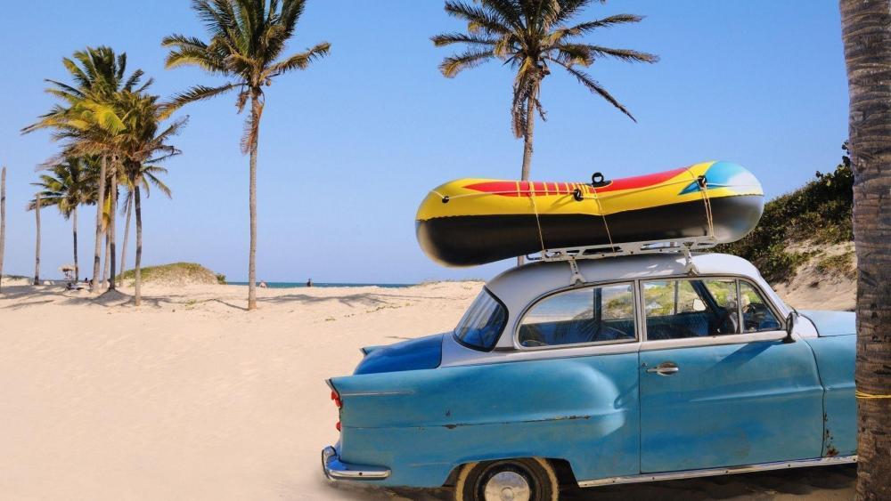 Vintage car on the beach wallpaper