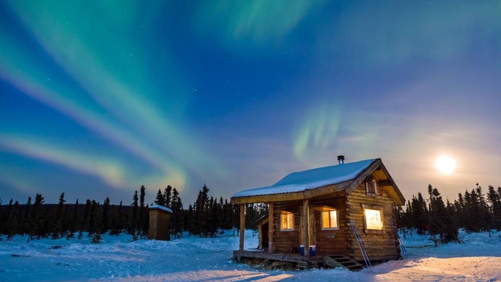 Hut under the northern lights wallpaper