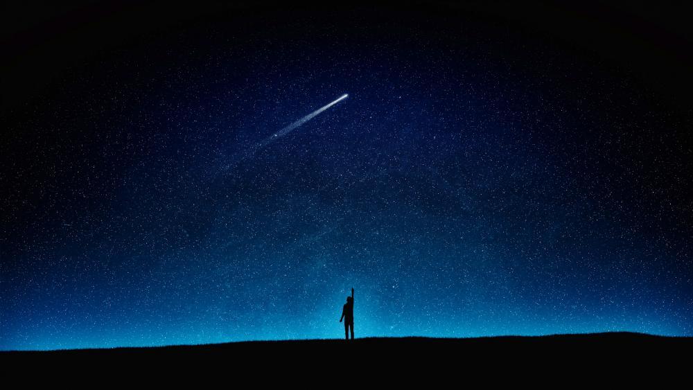 Comet on the starry night sky wallpaper