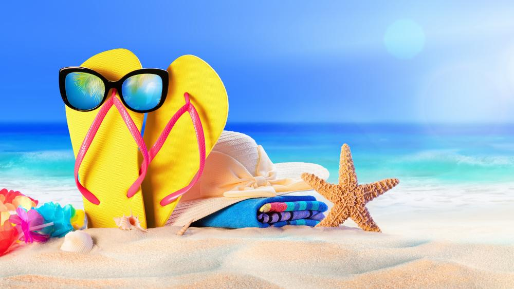 Flip flop with sunglasses on the beach wallpaper