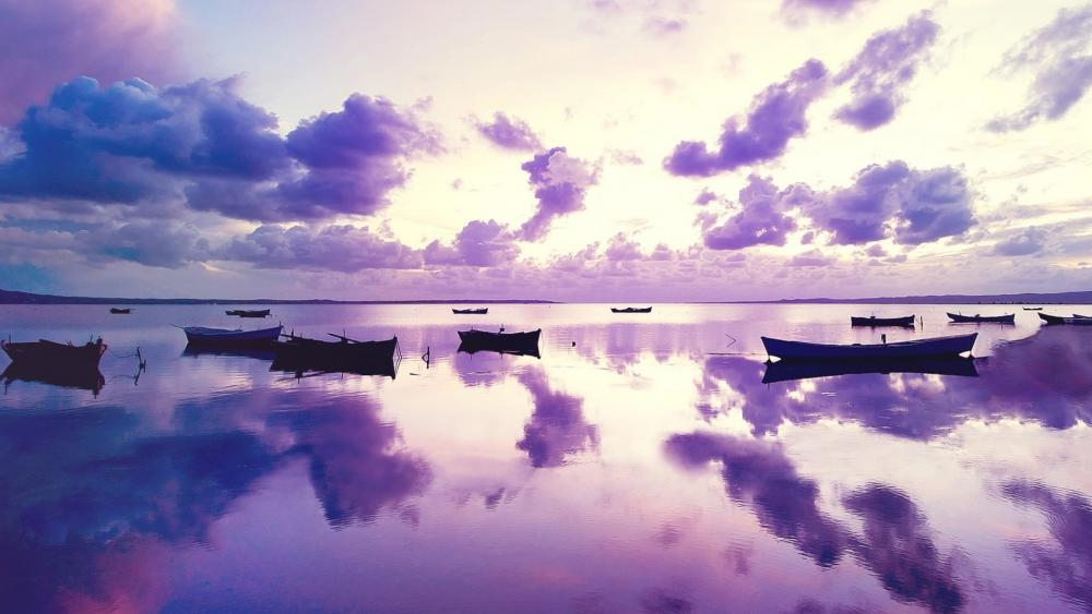 Purple sunset with boats wallpaper