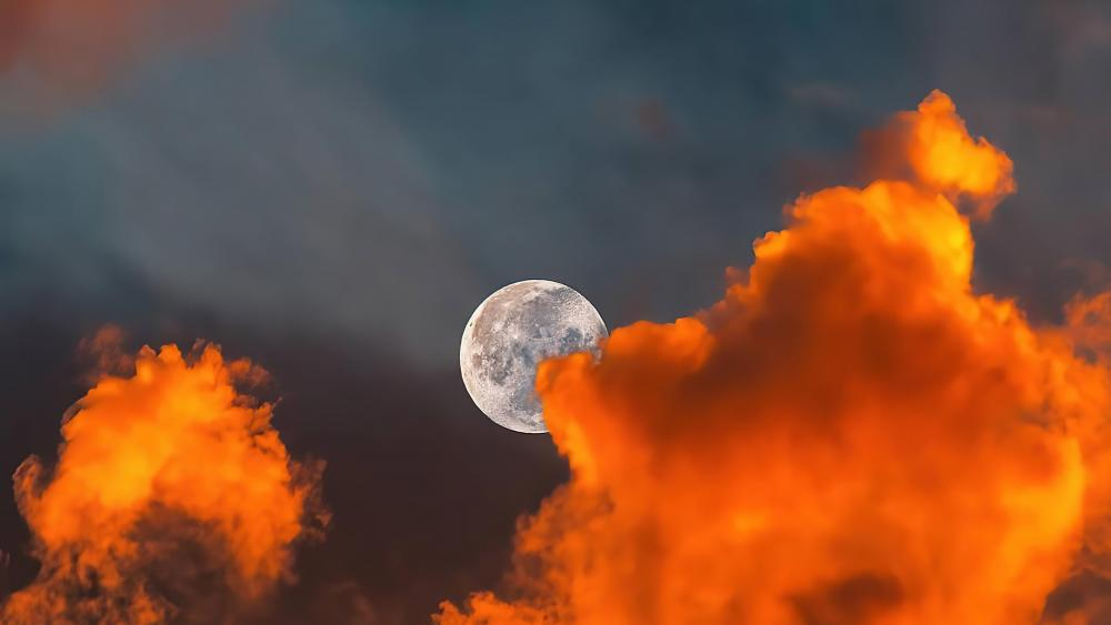 The moon behind clouds wallpaper