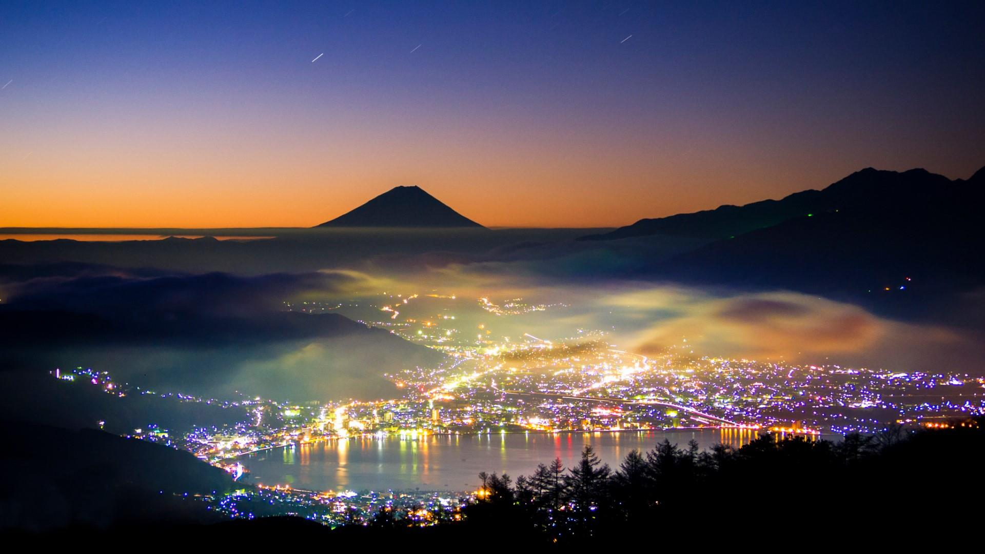 City lights at the foot of the Mount Fuji wallpaper
