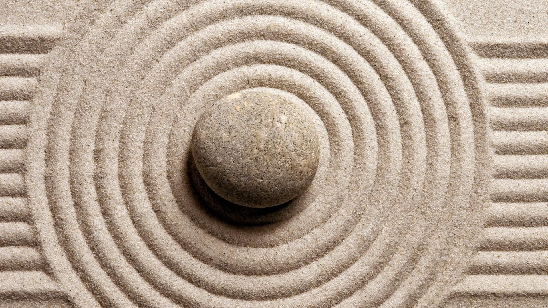 Zen stone in the sand ☯️ wallpaper