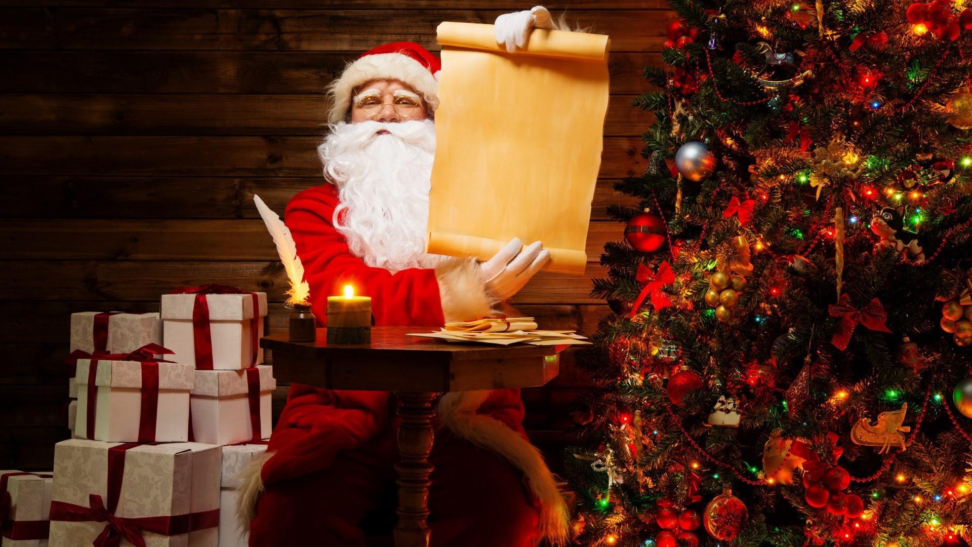 Santa Claus beside the Christmas tree wallpaper