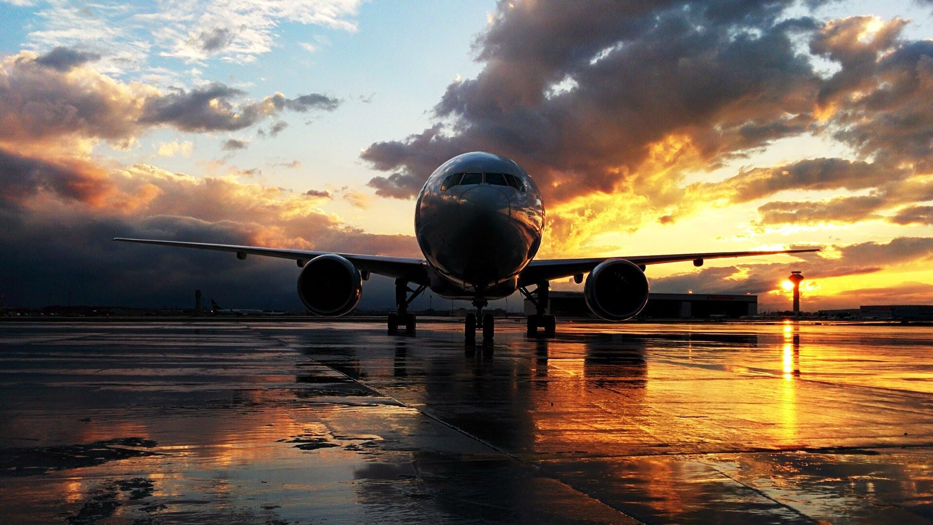 Airplane at sunset wallpaper