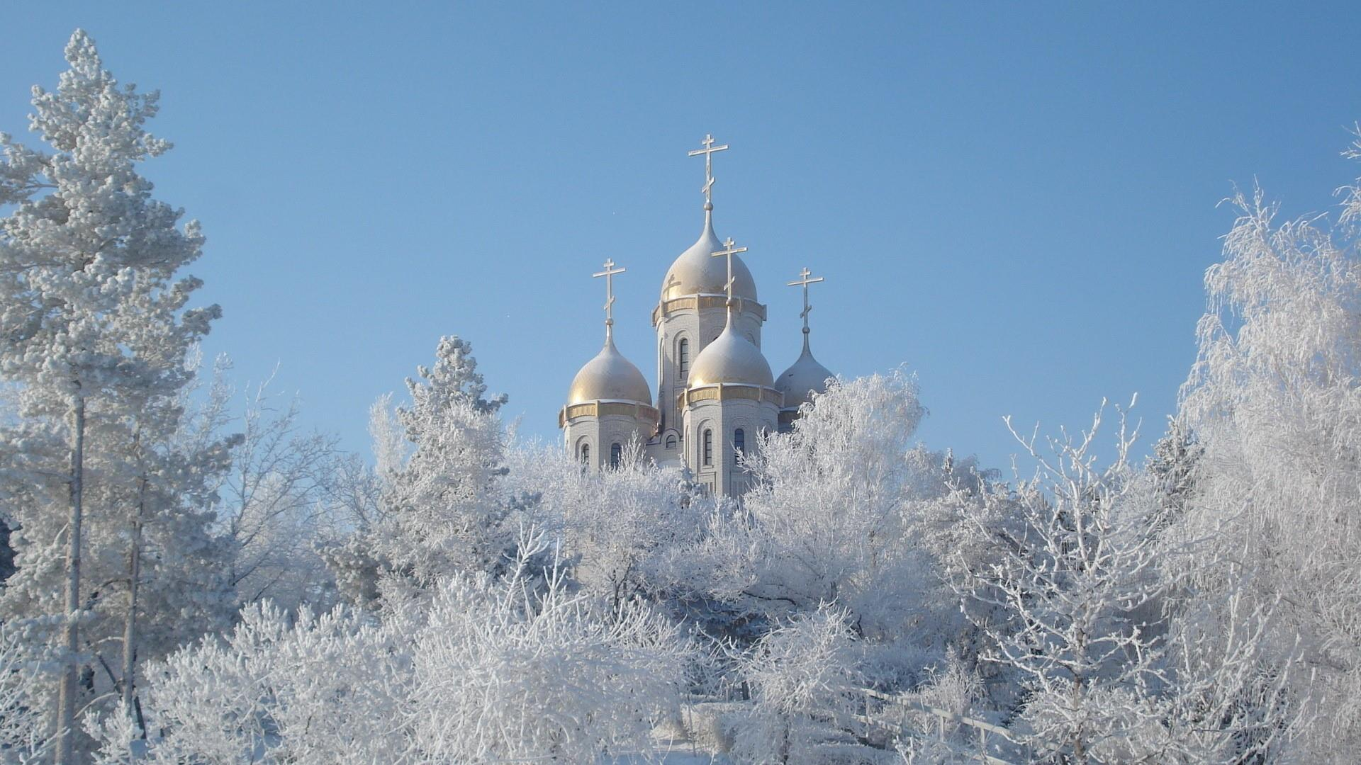 Winter with white trees and a church wallpaper